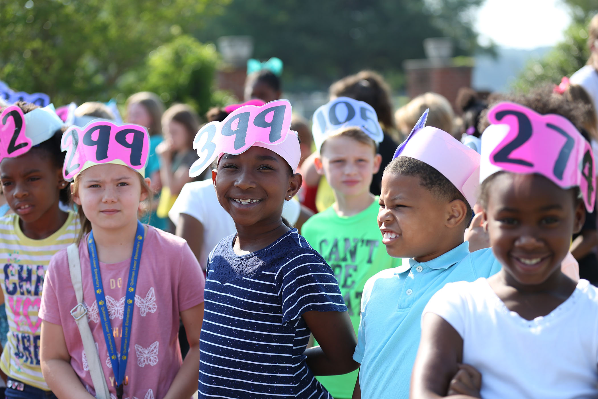 Students wear hats announcing how many books they have read.