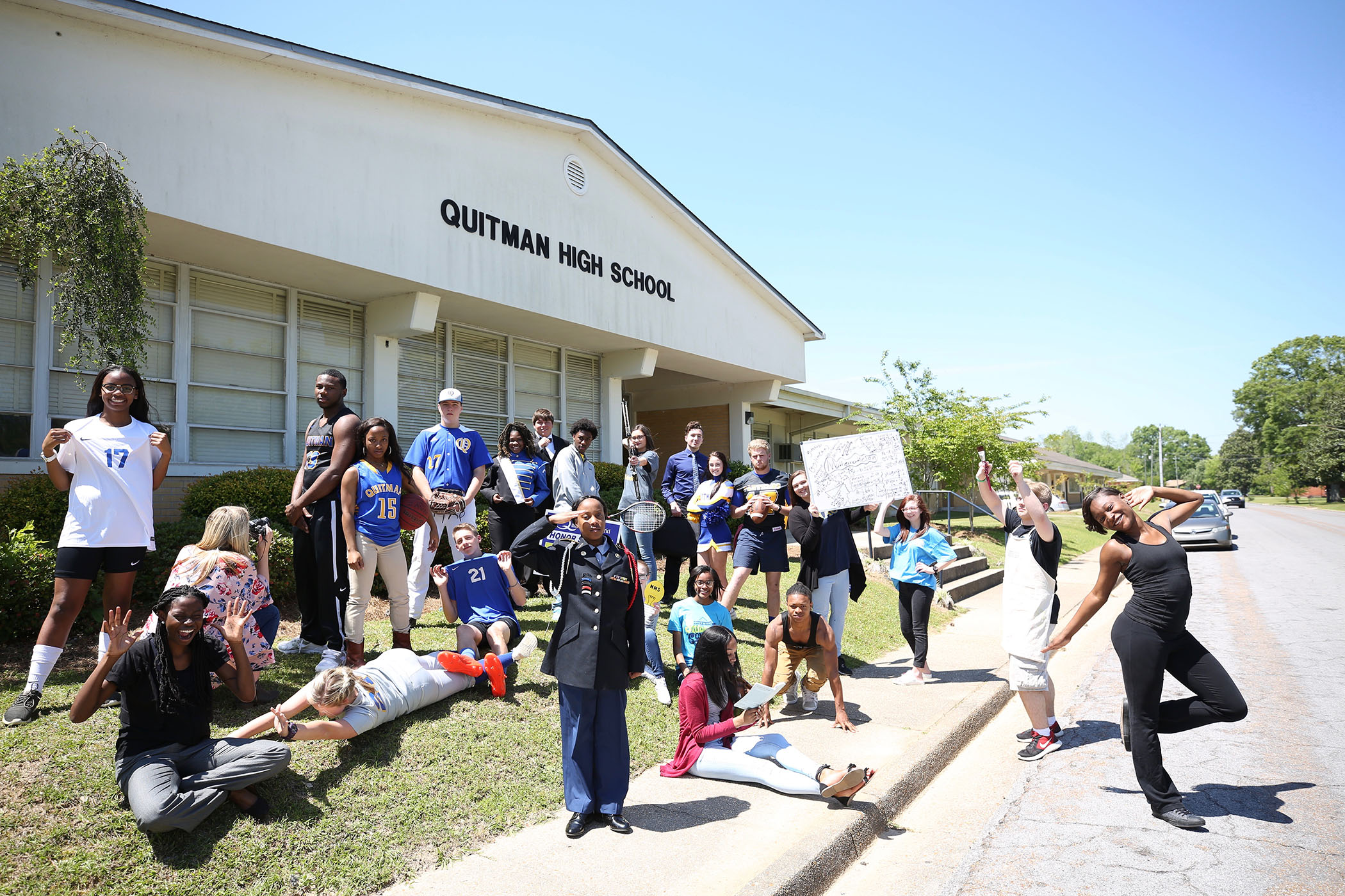 QHS students pose in front of their school.