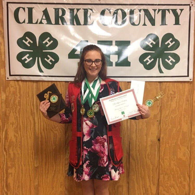 Brooklynn poses with her 4-H awards.