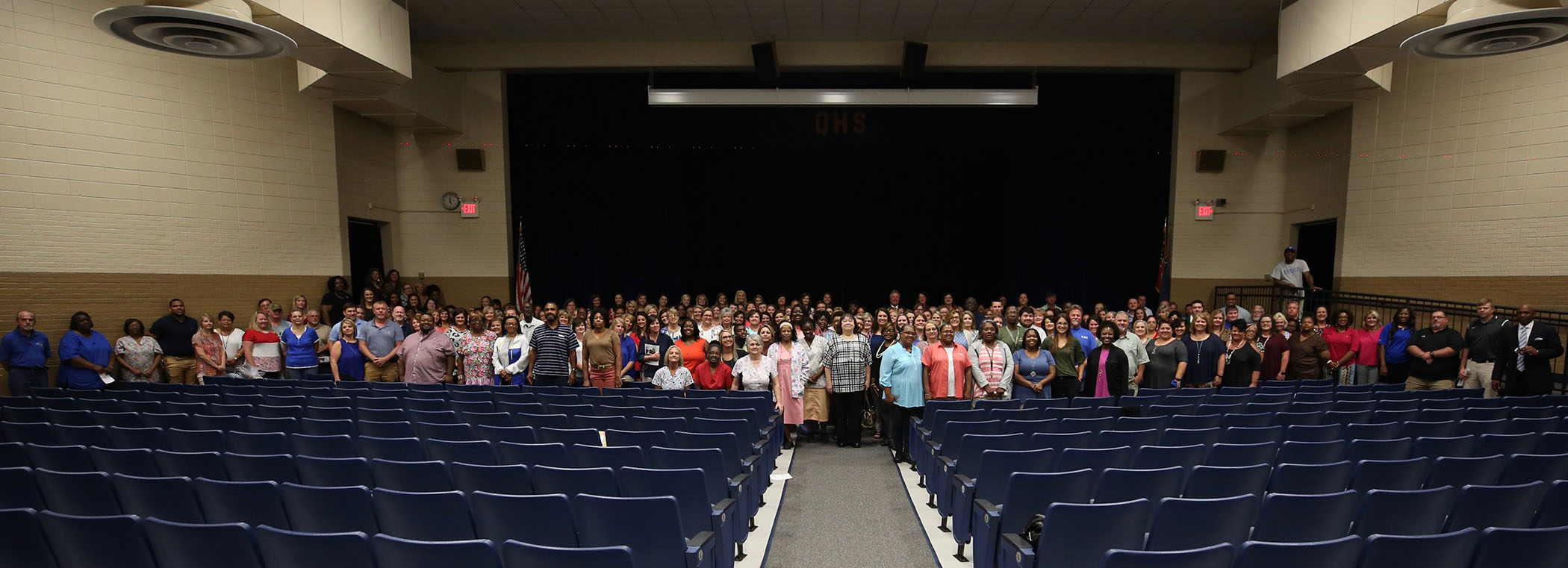 QSD faculty and staff populate the QHS auditorium.