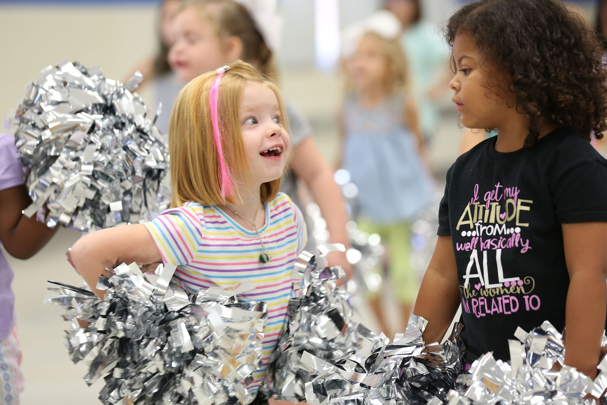 Panther Kittens practice with their pom poms.