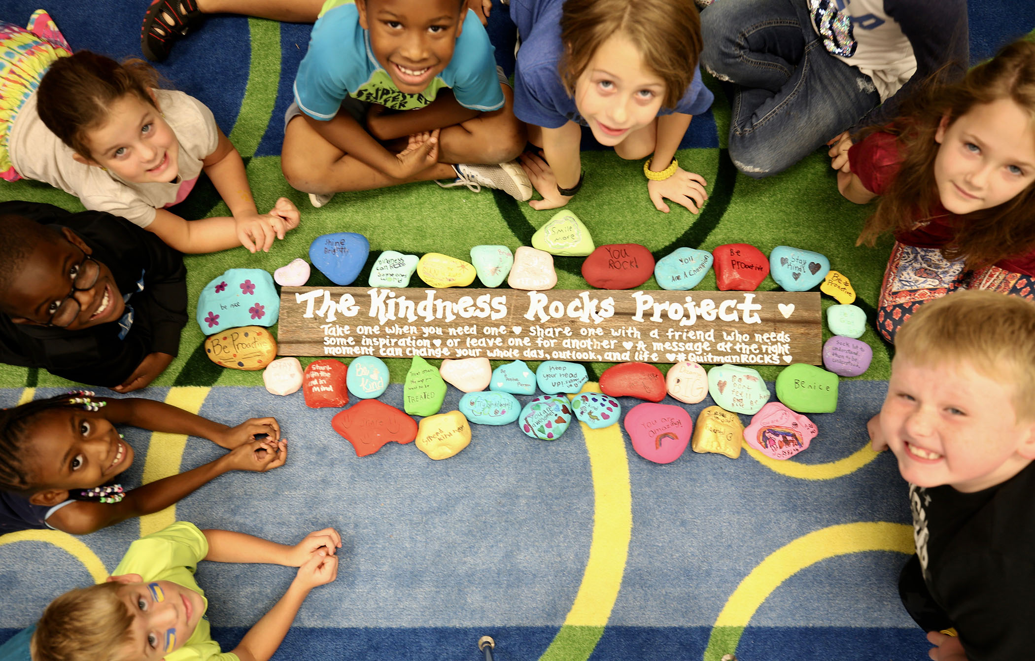 2nd Grade SWAT students gather around their Kindness Rocks Project.
