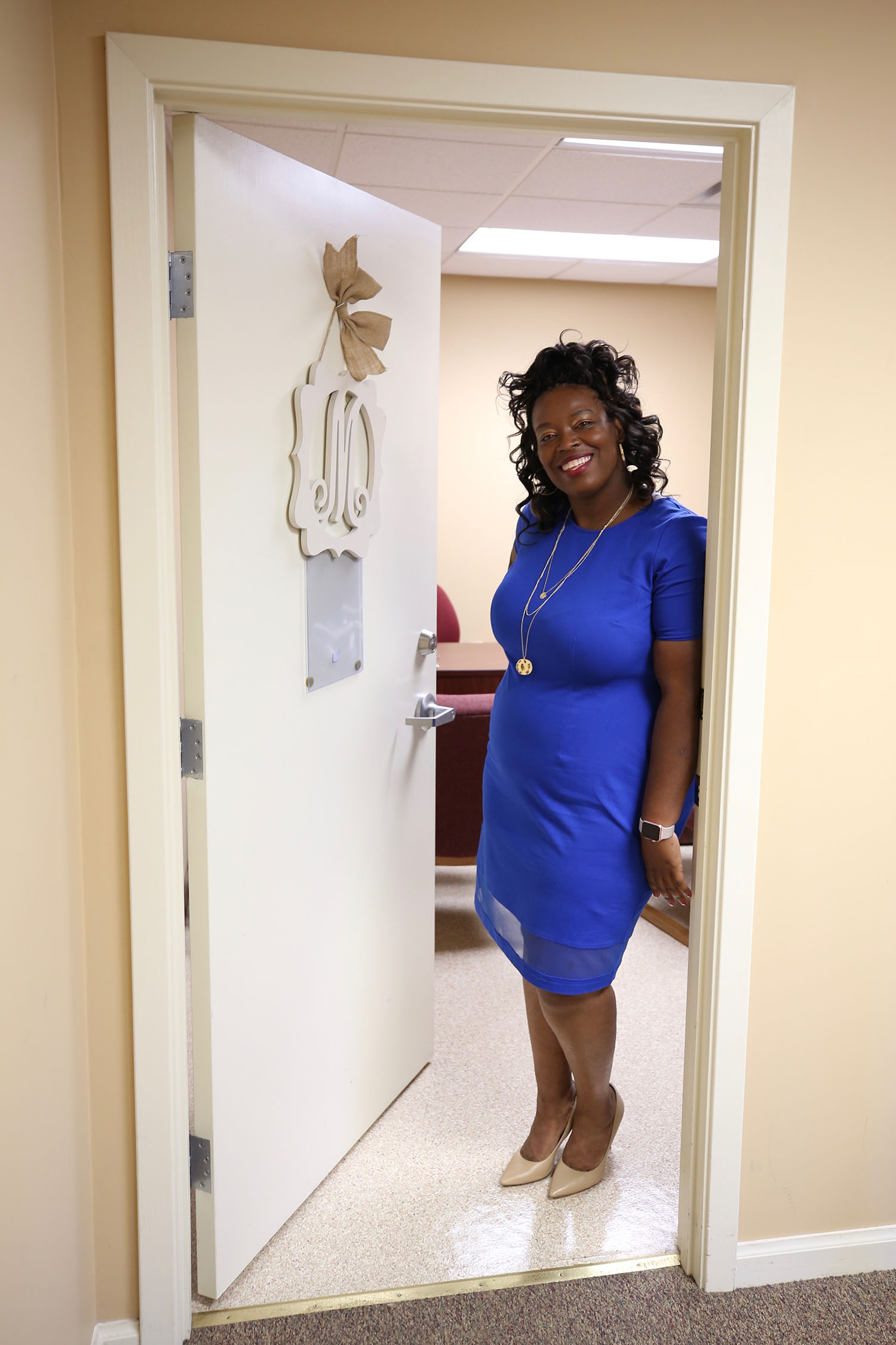 Natasha Mosley stands at the doorway of her office.