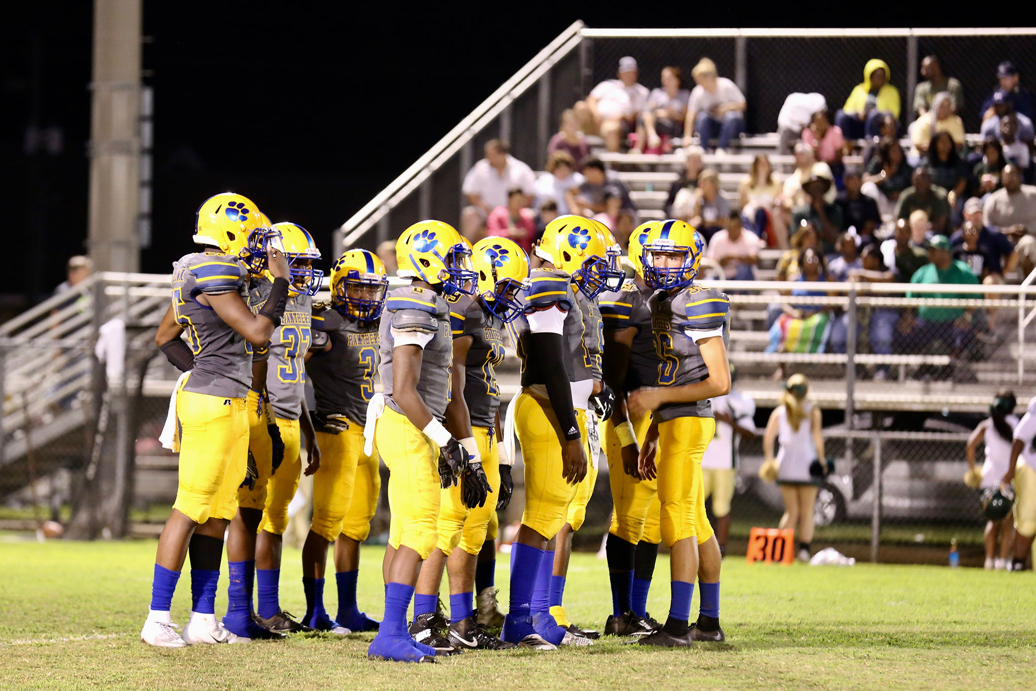 Panther Football huddles during a game.