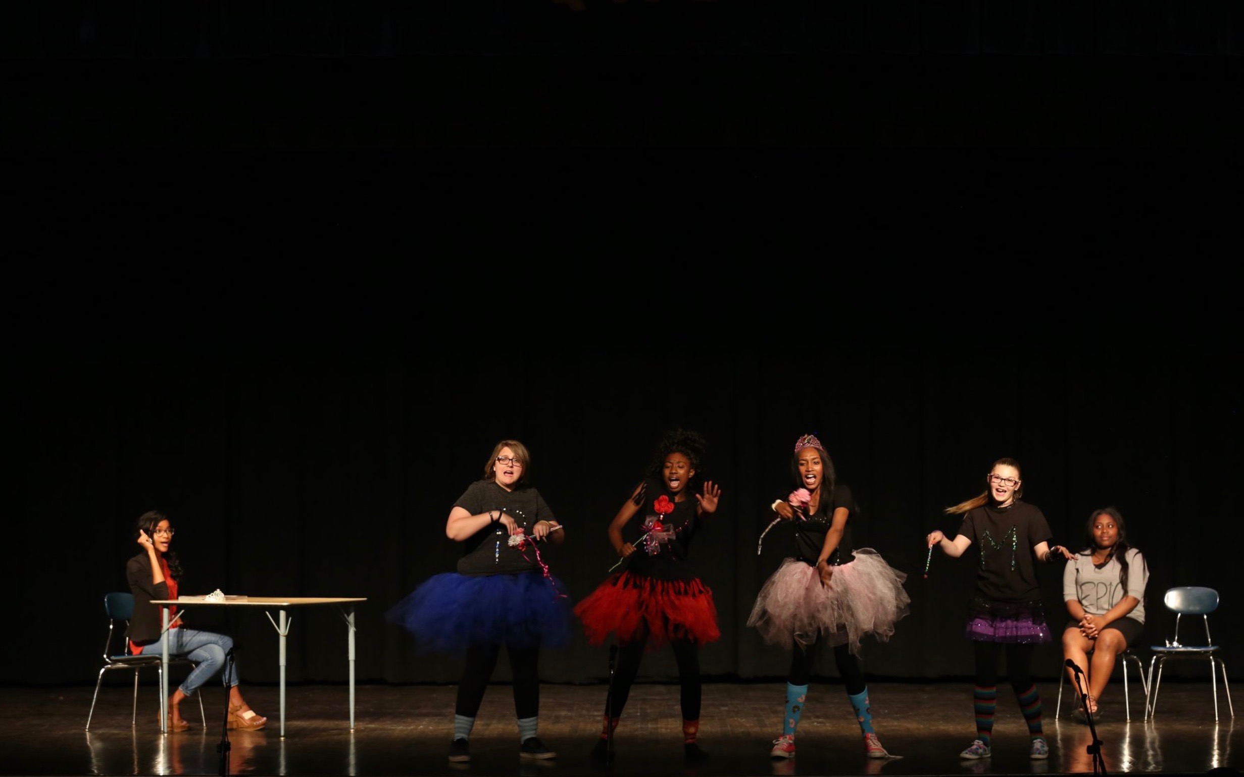 Harleigh and her fellow theatre classmates perform a skit on the stage of the QHS Auditorium.