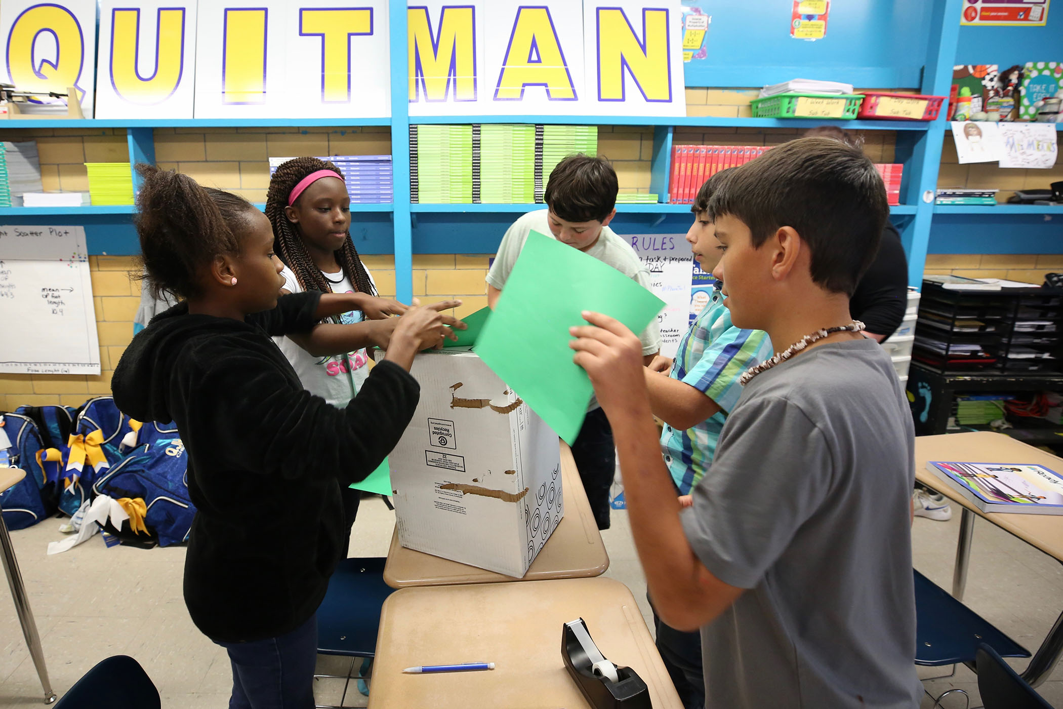 QJH students prepare boxes for recycling project.