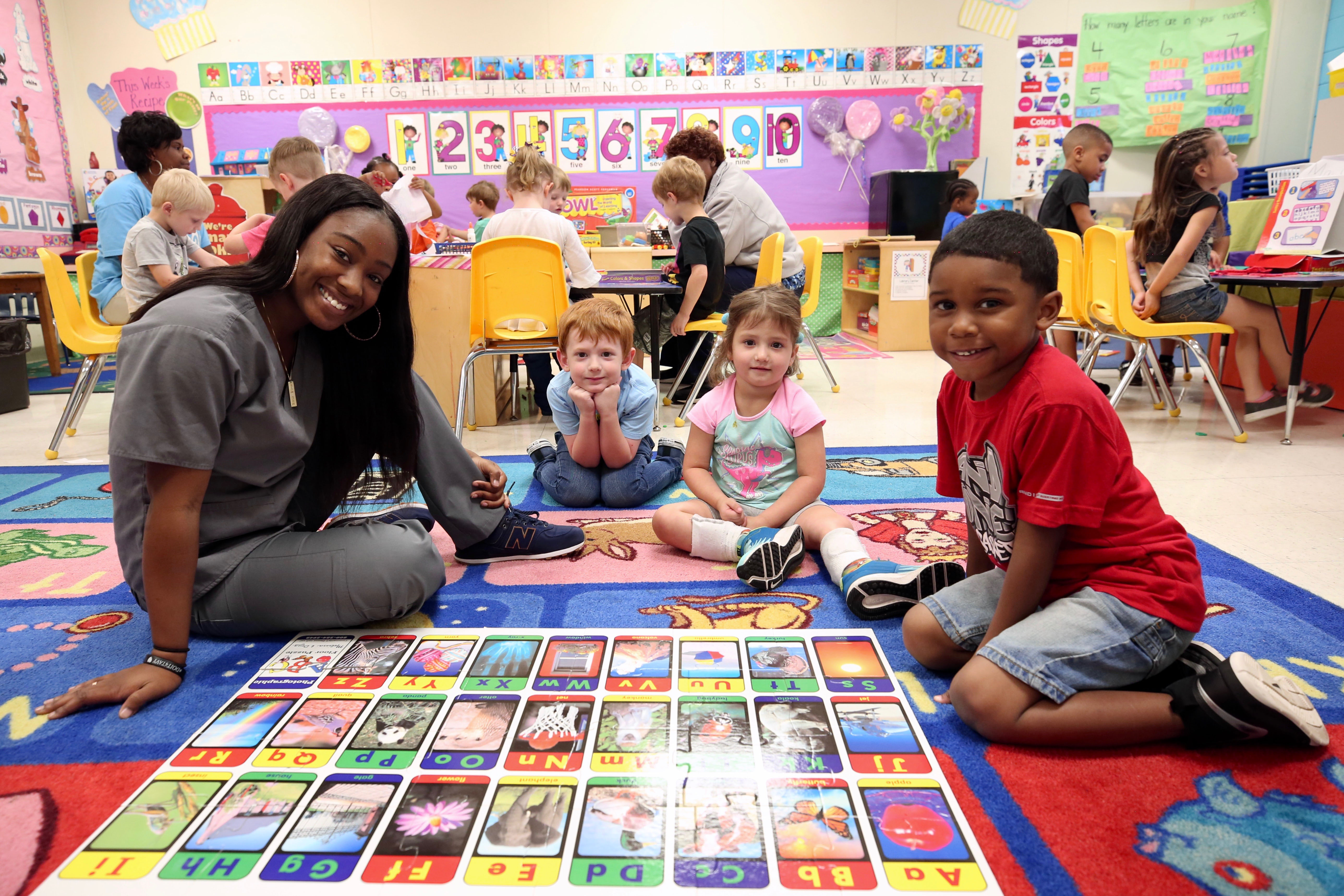 Keriunna poses with a QLE Pre-K class during her Early Childhood Education class.
