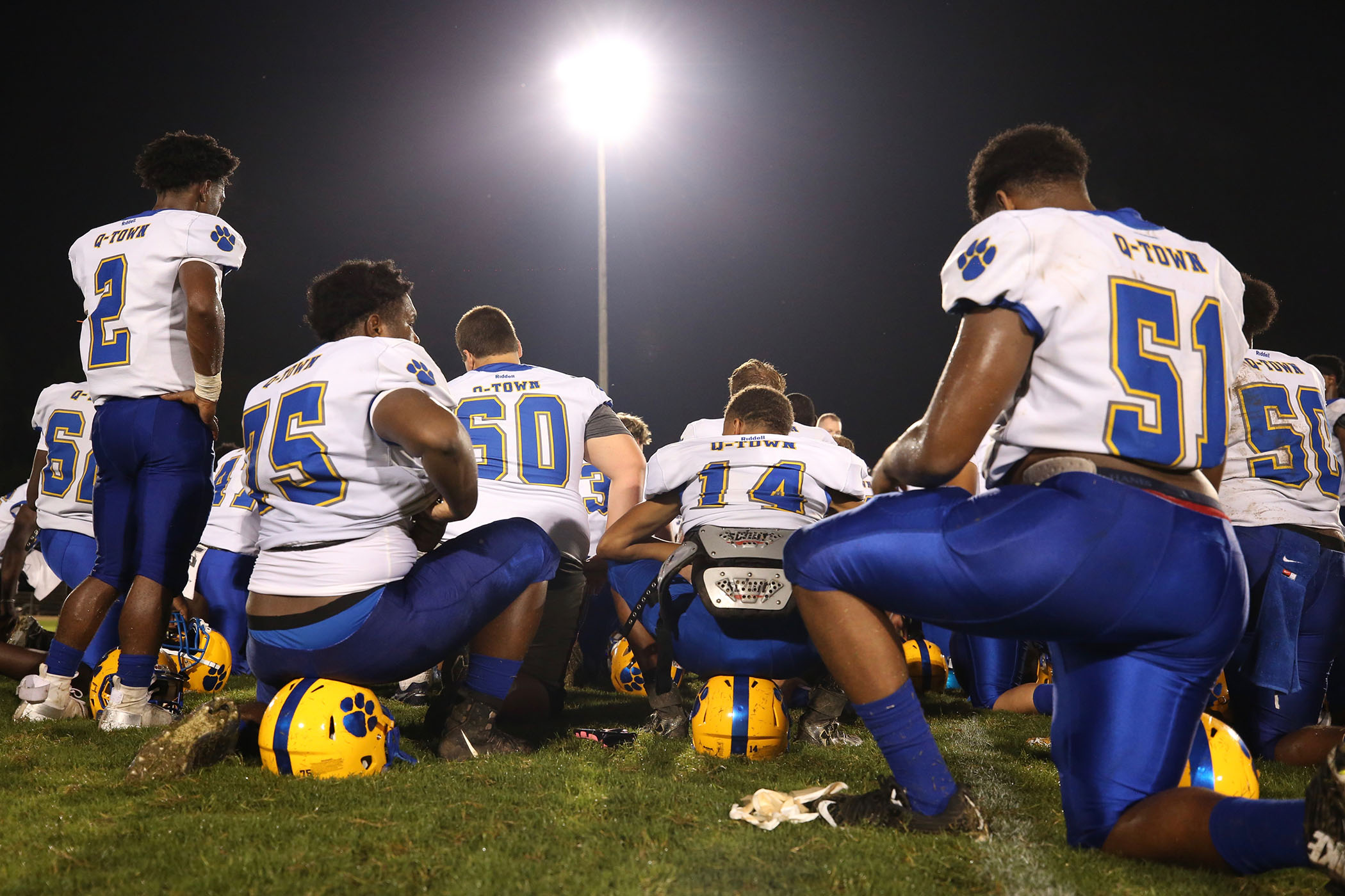 The Panther Football team listens to their coach after the game.