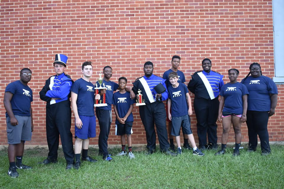 Big Blue Crew Percussion team stand with their Best in Class - Percussion award in 2018.