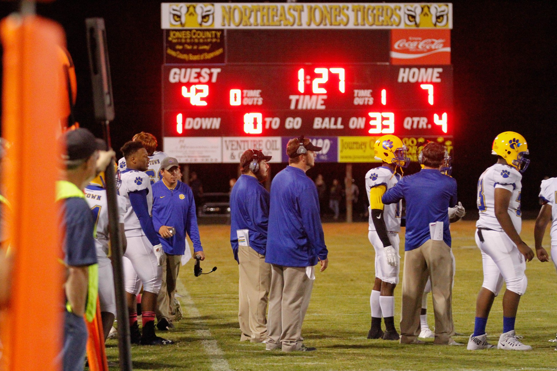 Panther players in front of the scoreboard at NE Jones.