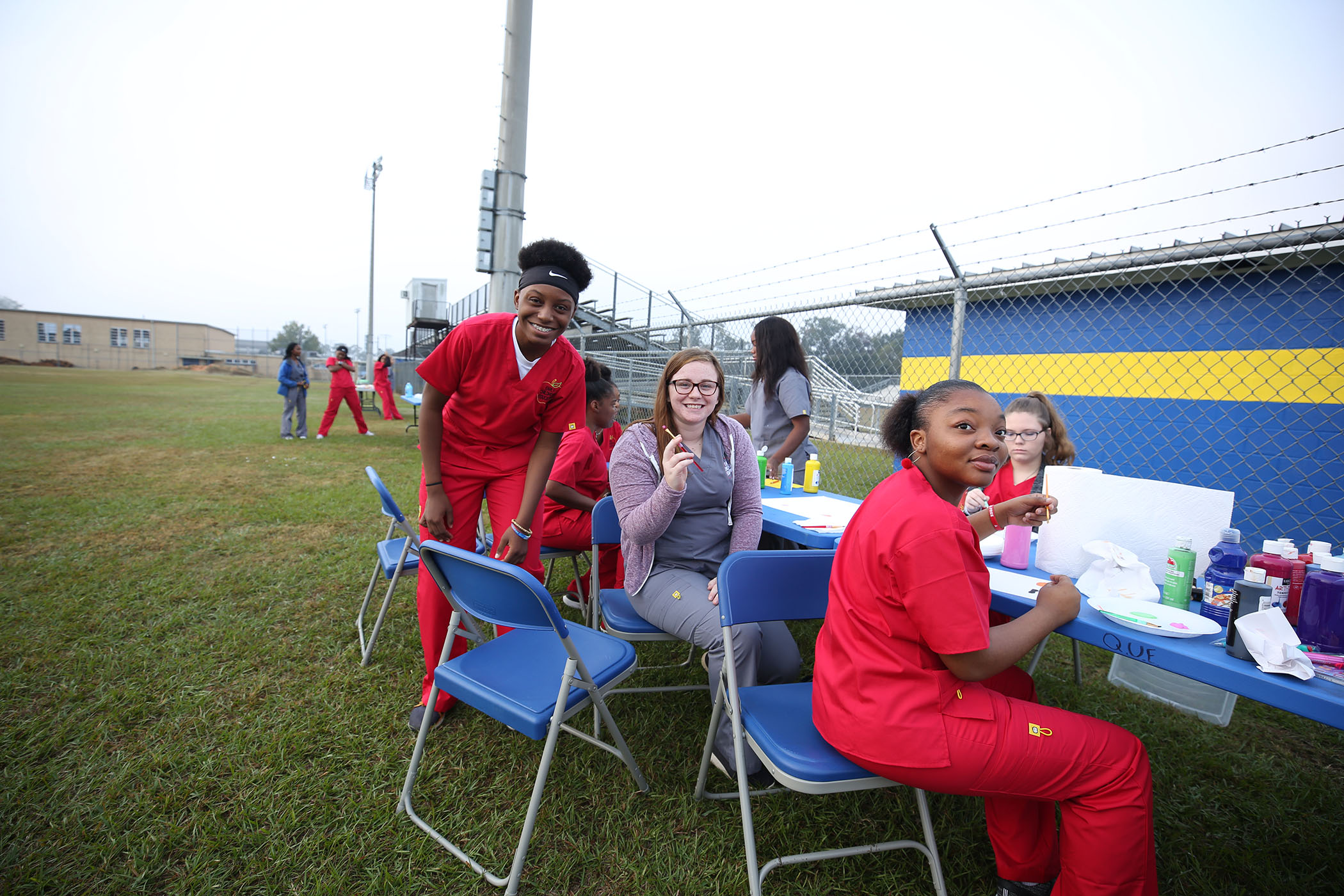 Students, parents, and staff enjoy the QUE Fall Festival.
