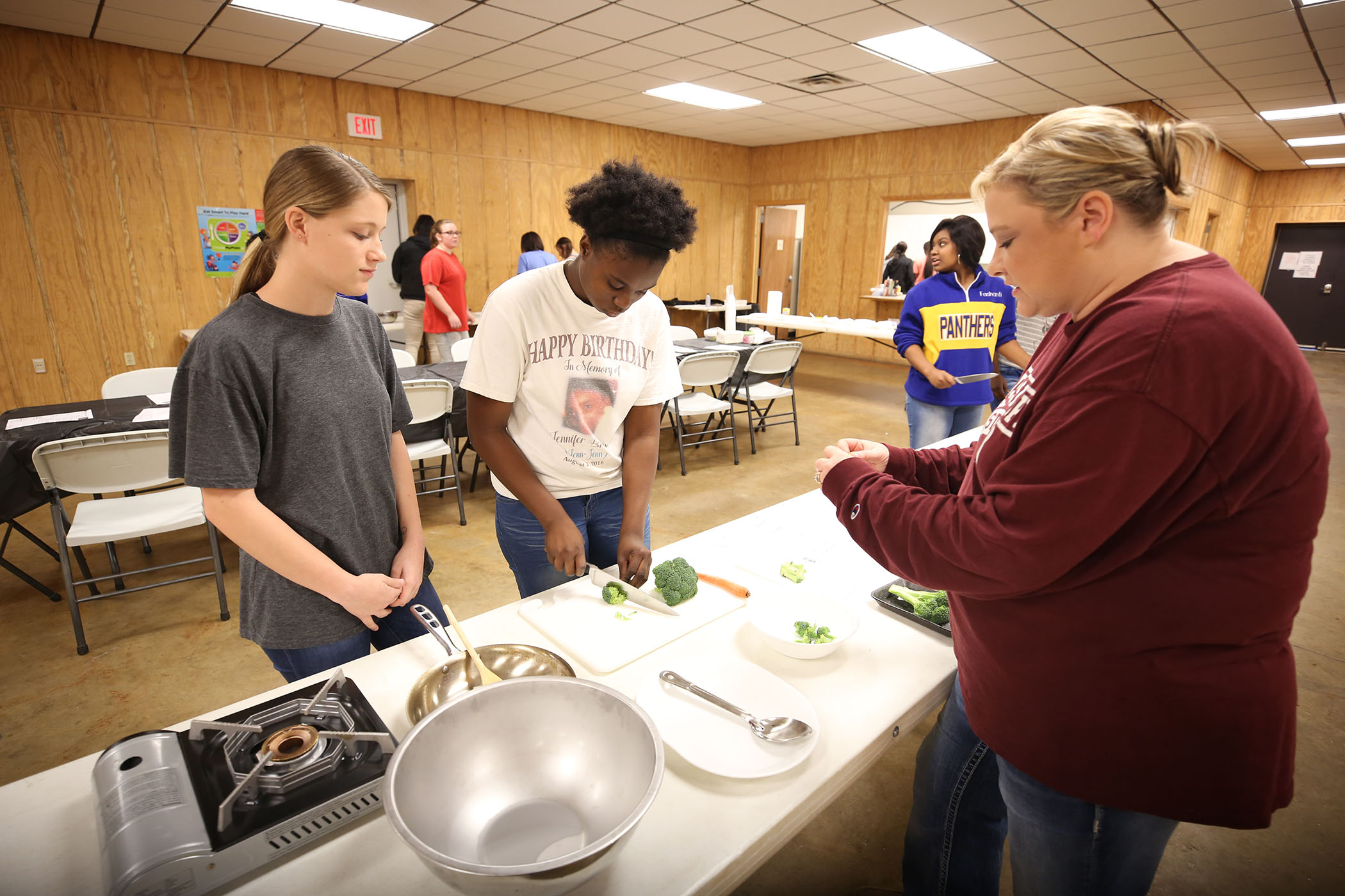 ECE students prepare a meal together.