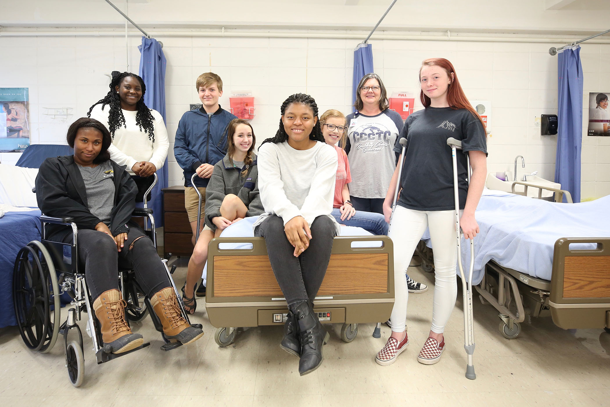 Jaureka poses with her peers and instructor in Health Science class.