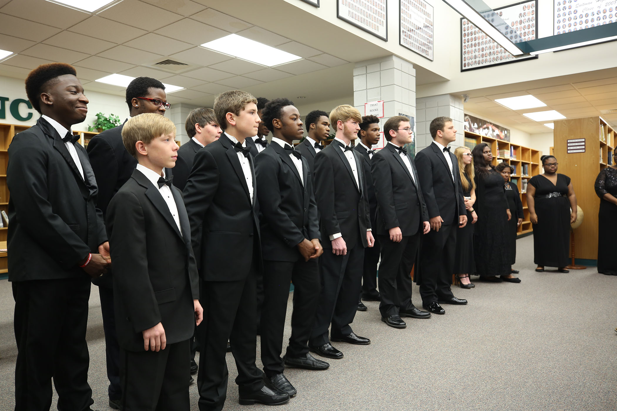 QHS Choral students provide a concert in the QHS Library.