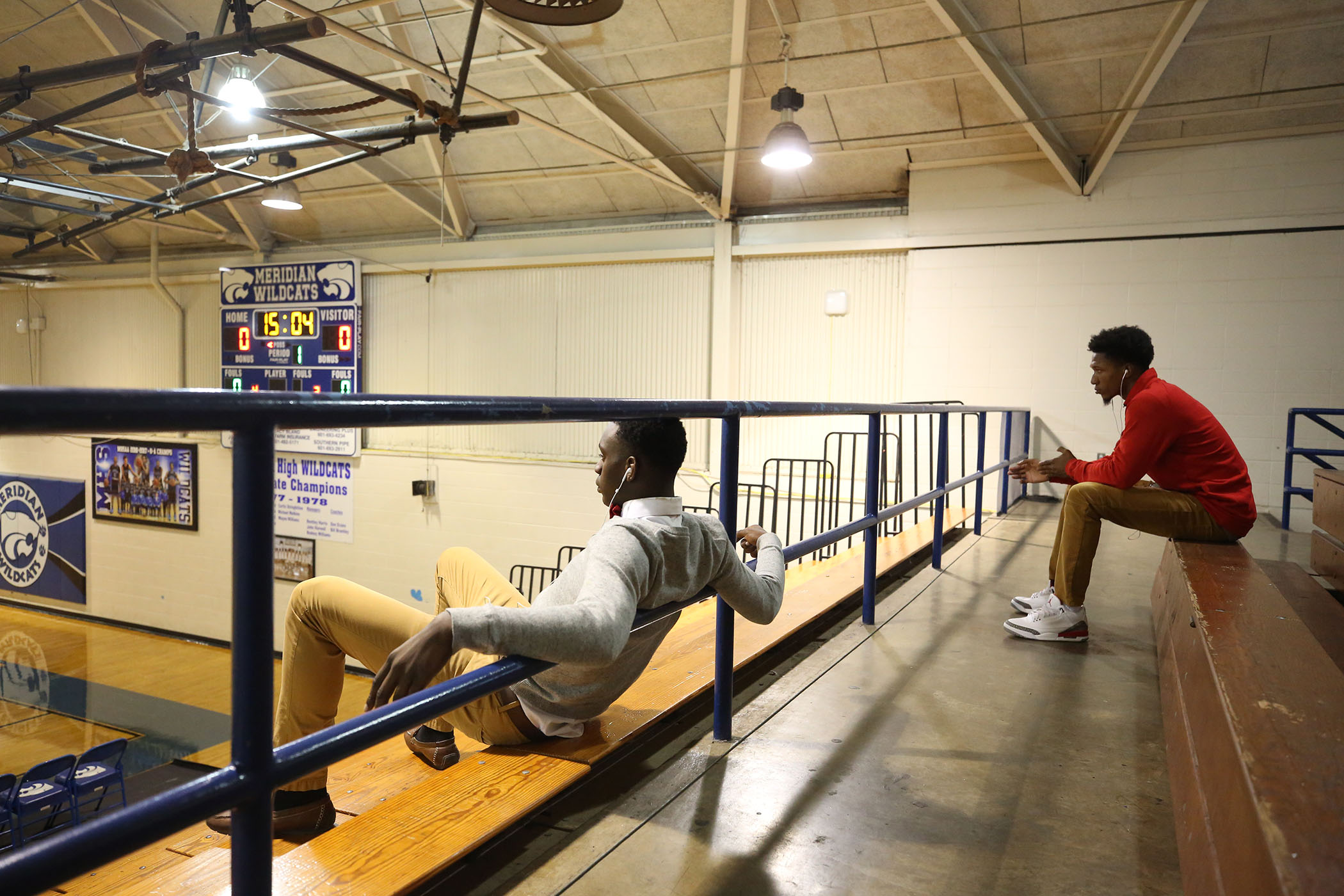 Two Panther basketball players wait for the upcoming game.