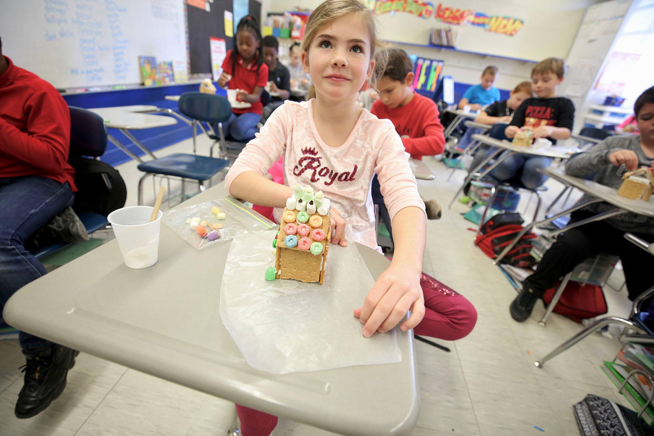 Mrs. Lafferty's 3rd grade class decorates her room with homemade gingerbread houses.