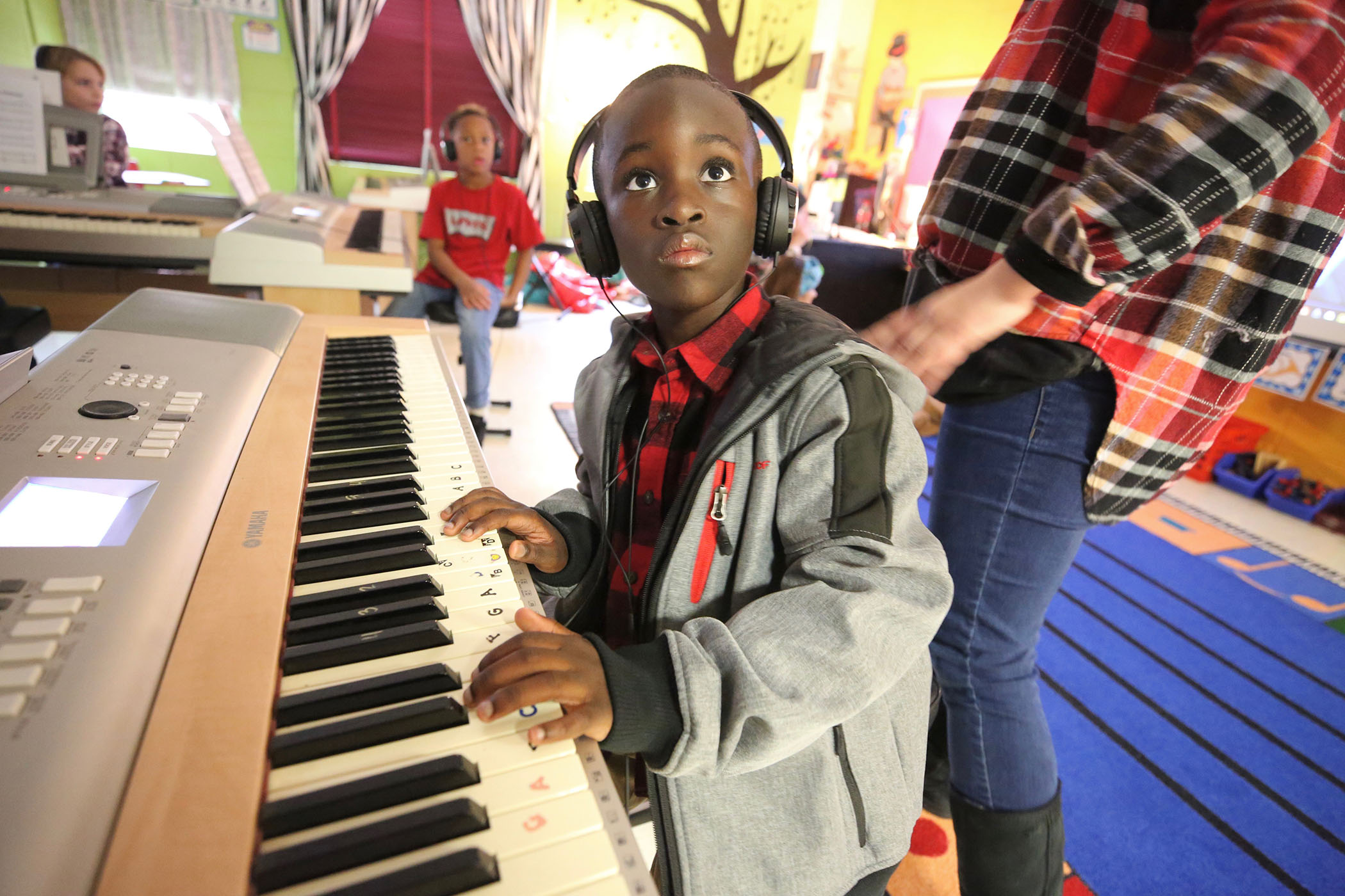 A QLE student practices piano.