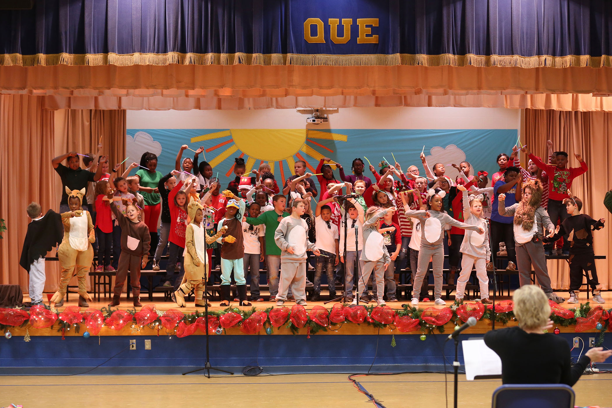 QUE 3rd grade students perform a Christmas musical.