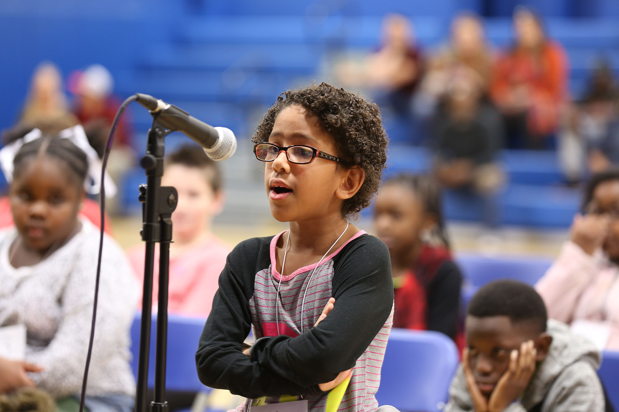 A QUE student competes in the school's spelling bee.