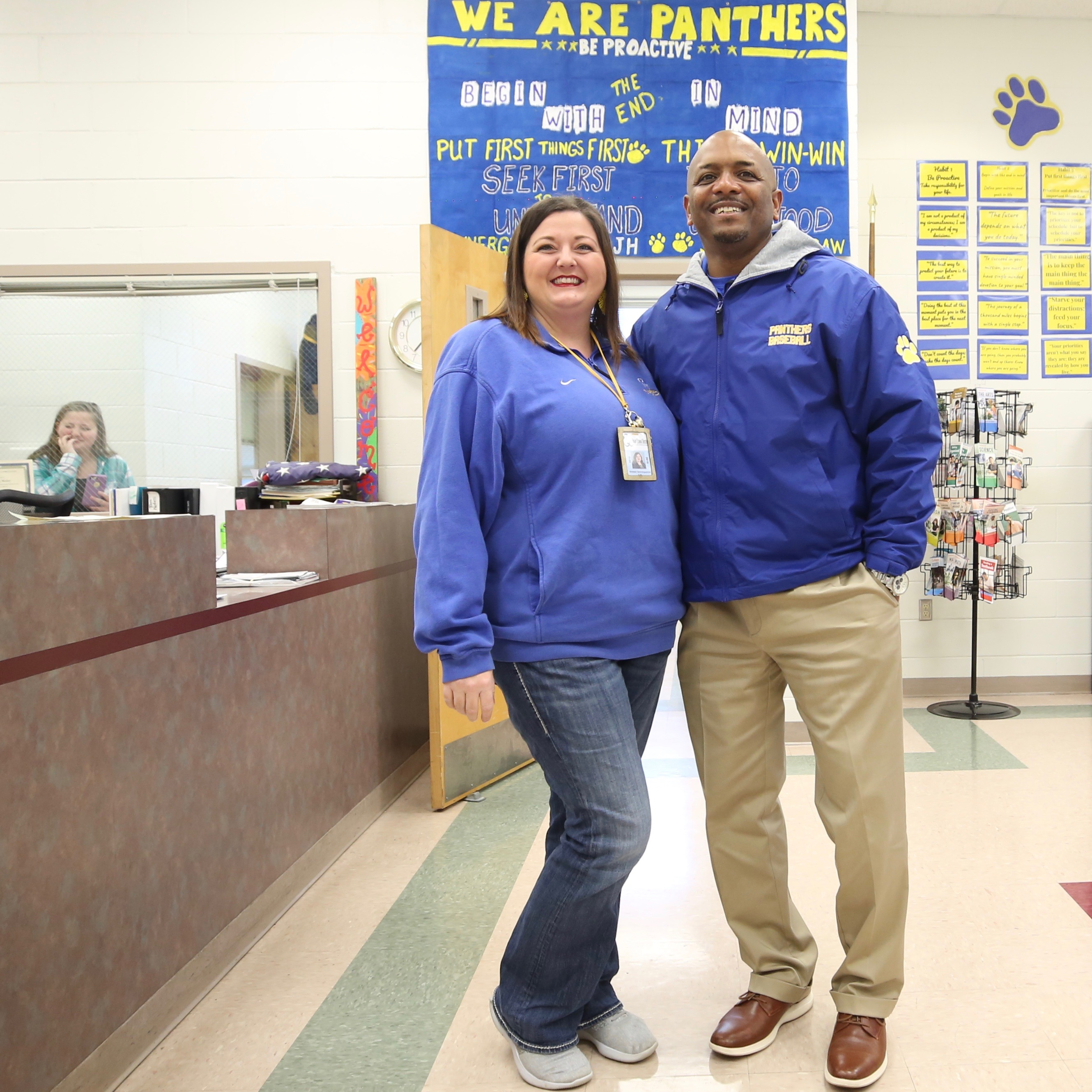 Mrs. Schrimpshire and Dr. Holloway pose in blue to signify their support of public schools.