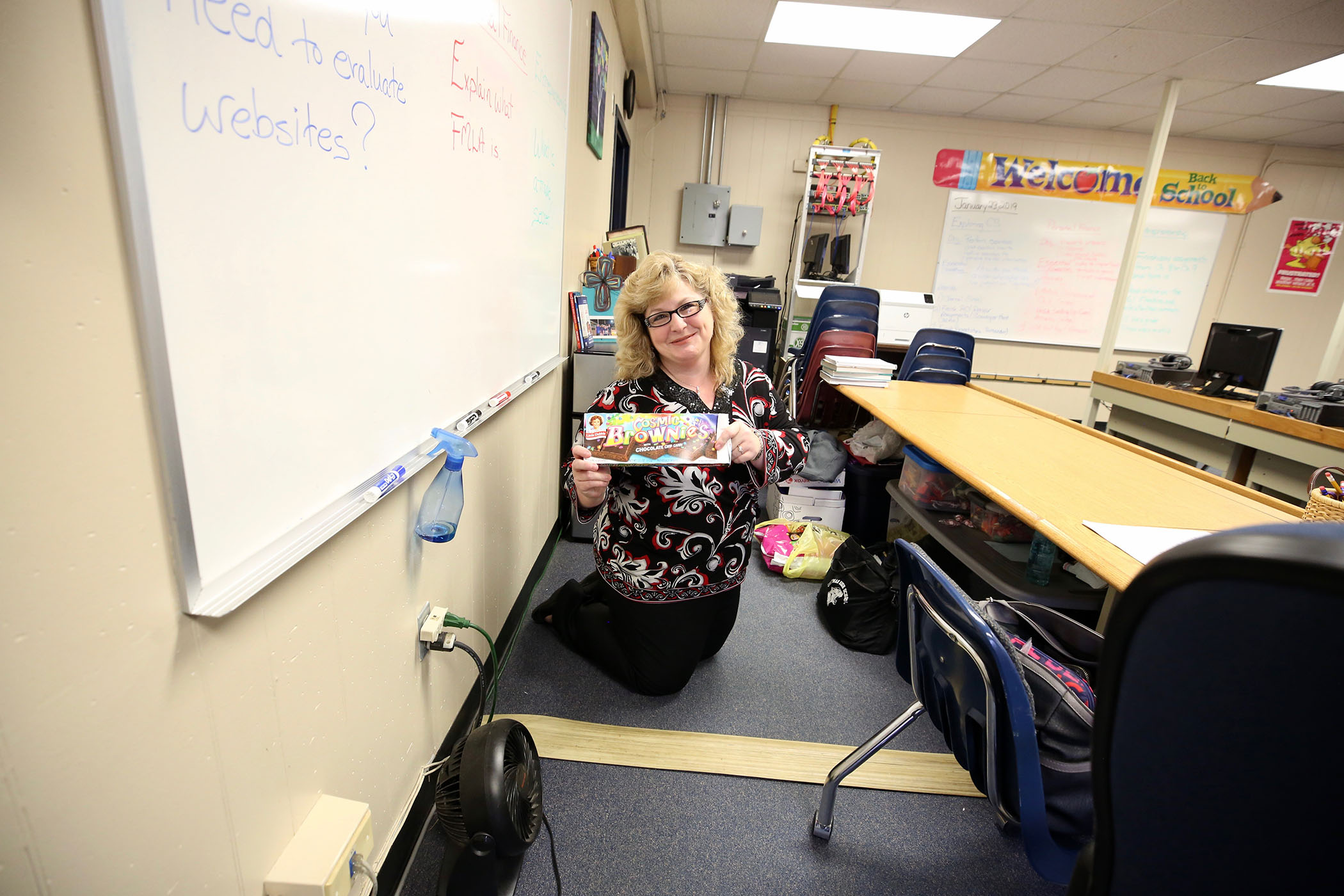 Mrs. Alford holds up snacks she has bought for her students.