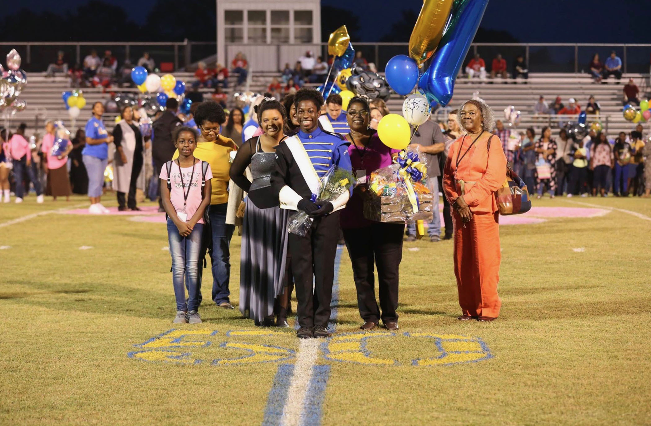 Julian poses at QHS Senior Night with his family.