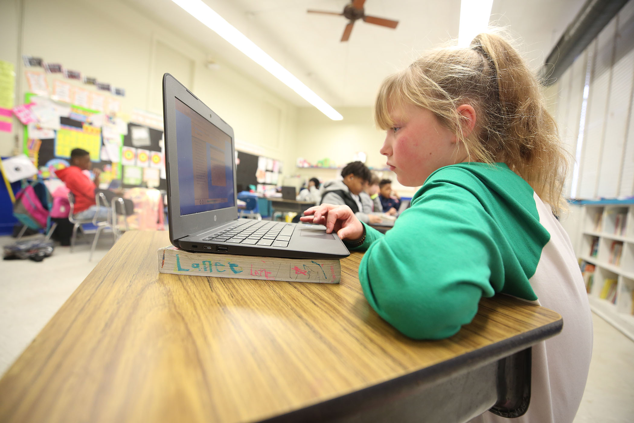 A fourth grade student works on her computer.