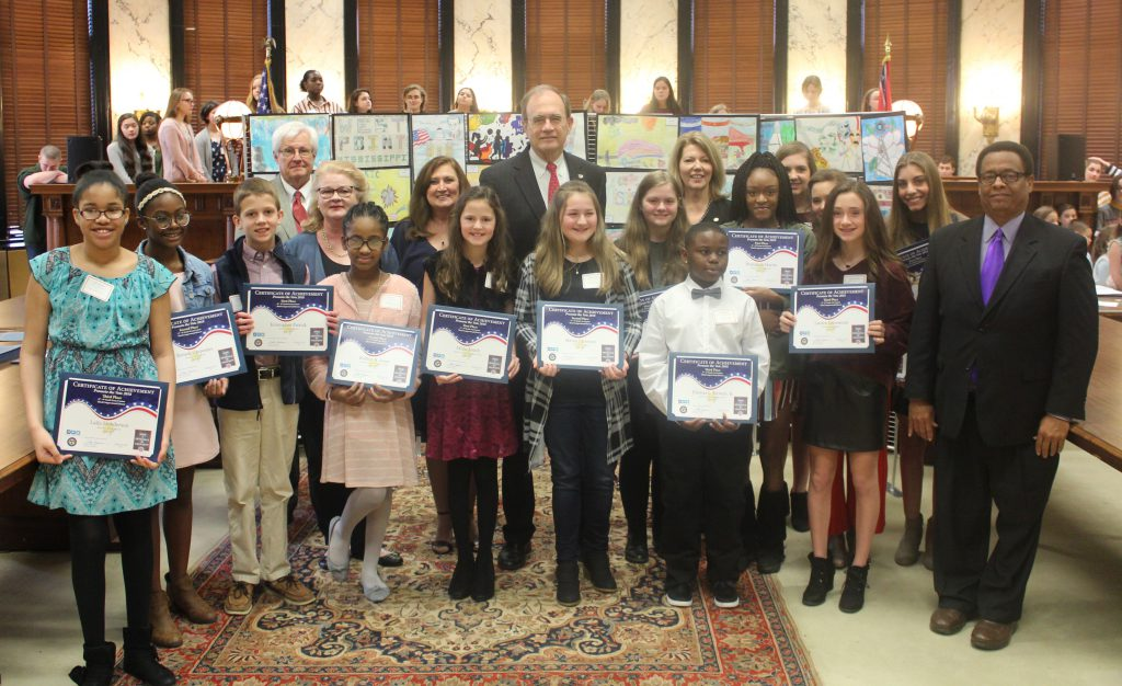 3rd Congressional District art winners stand with Mississippi Secretary of State.