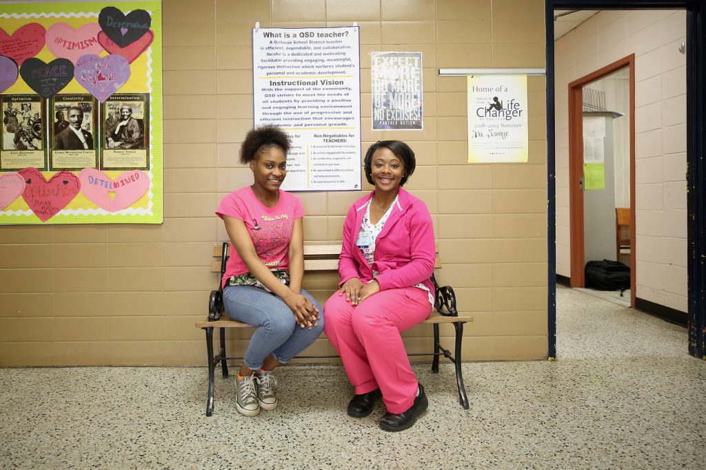 Doris Douglas R.N., M.S.N. poses with a student.