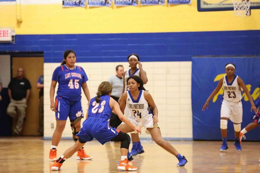 Natalie plays Panther basketball.