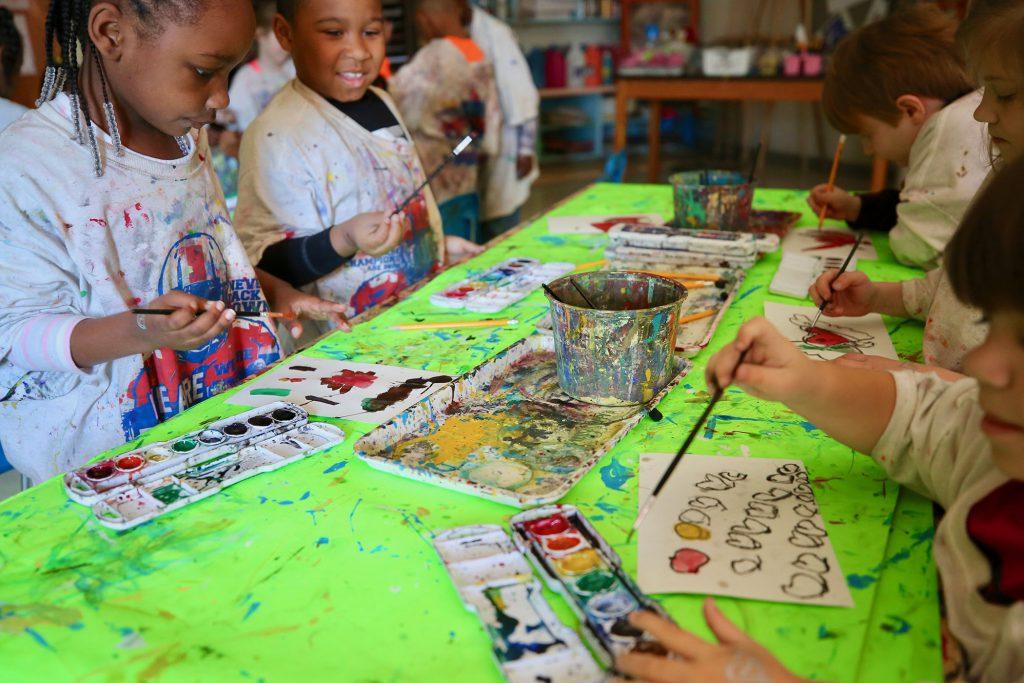 QLE students enjoy art class.