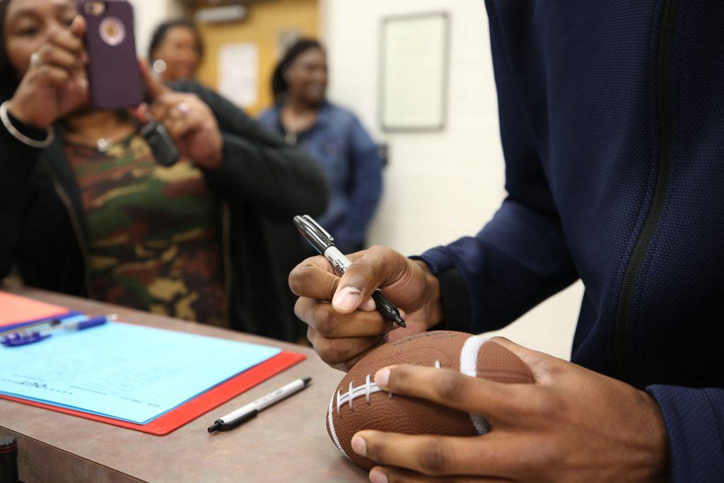Tarvarius Moore signs autographs at Quitman Junior High.