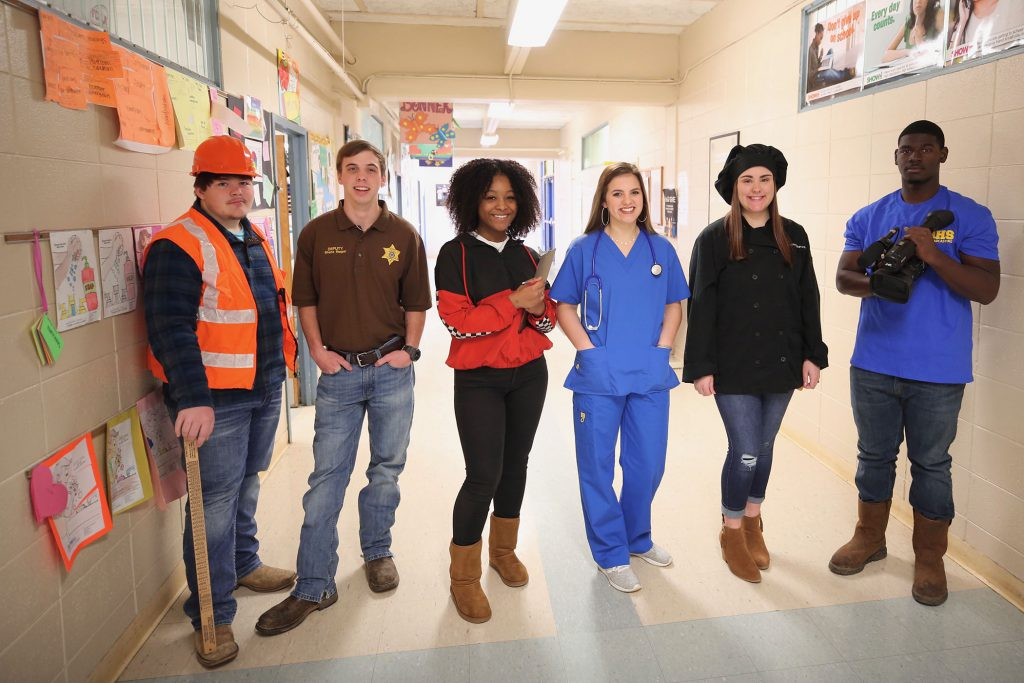 Career Tech students pose for a photo illustrating their programs.