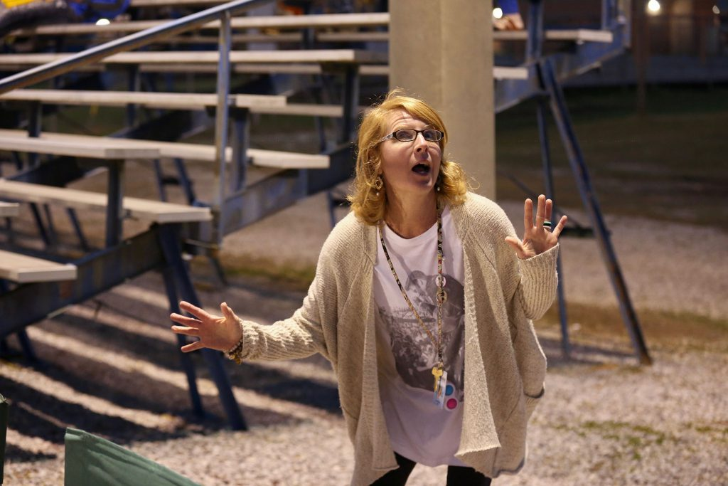 QLE art teacher attends Panther Fast Pitch games.