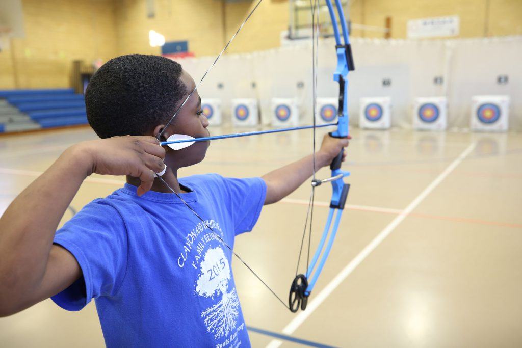 A Panther archer shoots at his target.