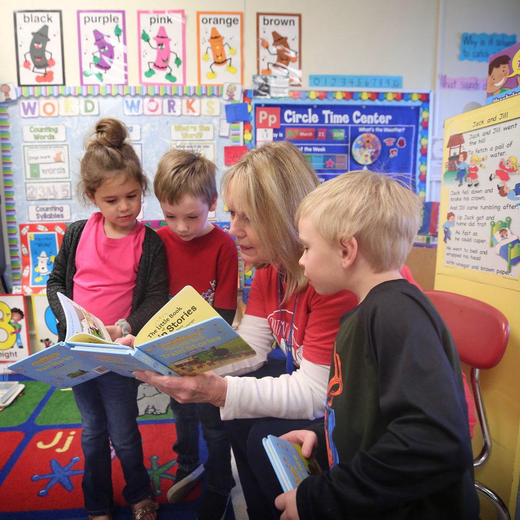 Stephen's mom delivers books to his Pre-K classroom at QLE.