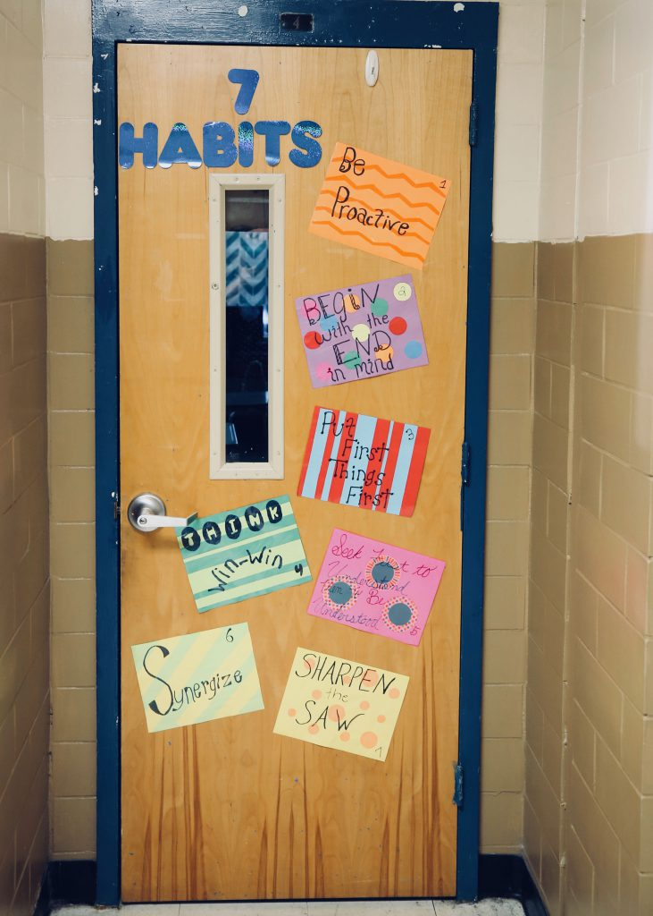 A door at QJH is decorated with the 7 Habits.