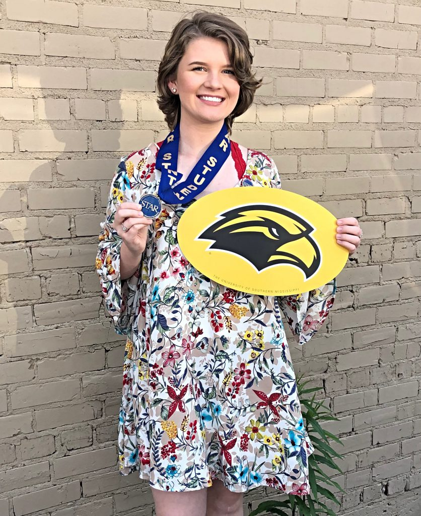 Clancy poses with her Golden Eagle sign.