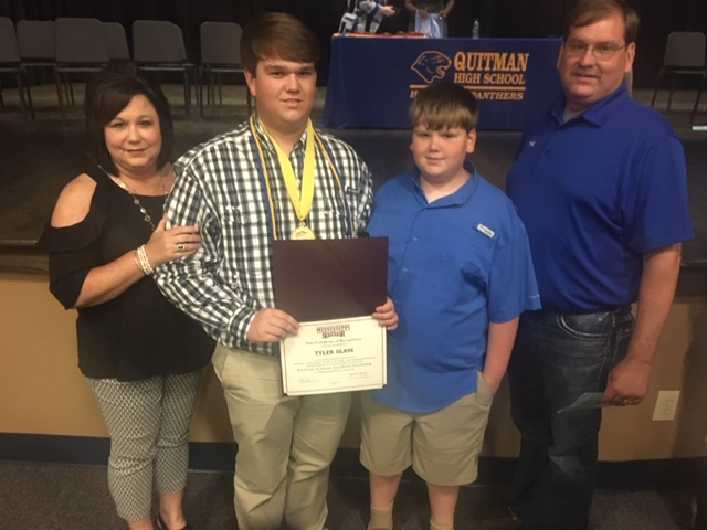 Tyler poses with his family on QHS Awards Night.