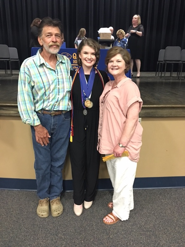 Clancy poses with her family.