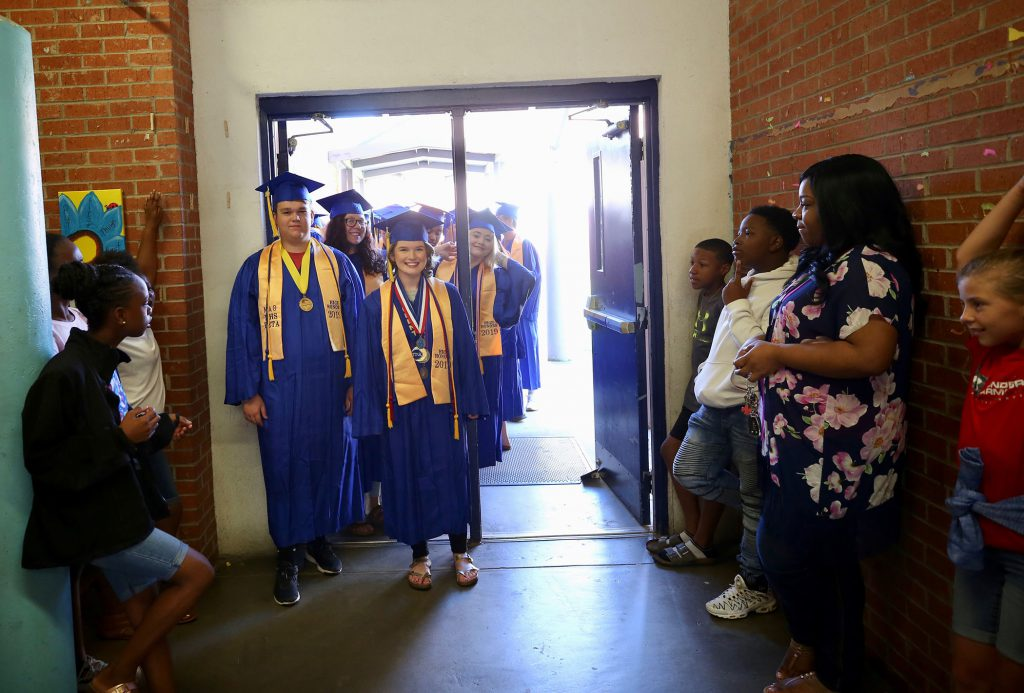 Clancy leads the 2019 Parade of Graduates.