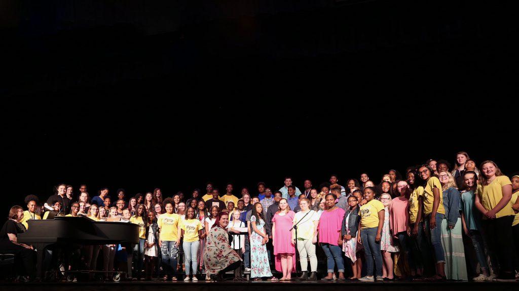 The QJH Chorus performs in the QHS Auditorium.