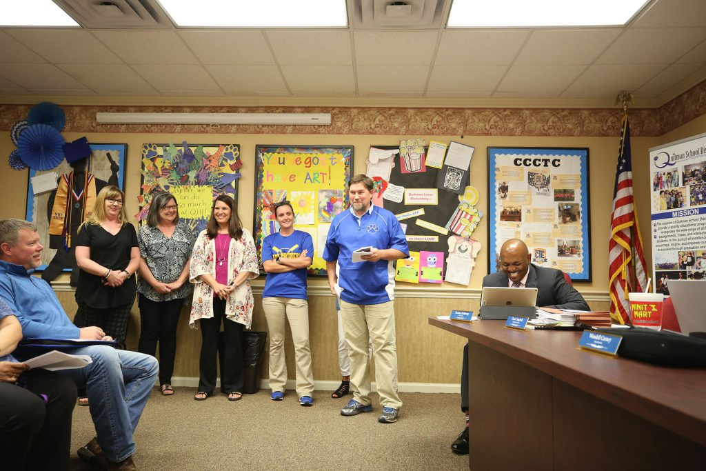 Presentations are made at the QSD School Board meeting.