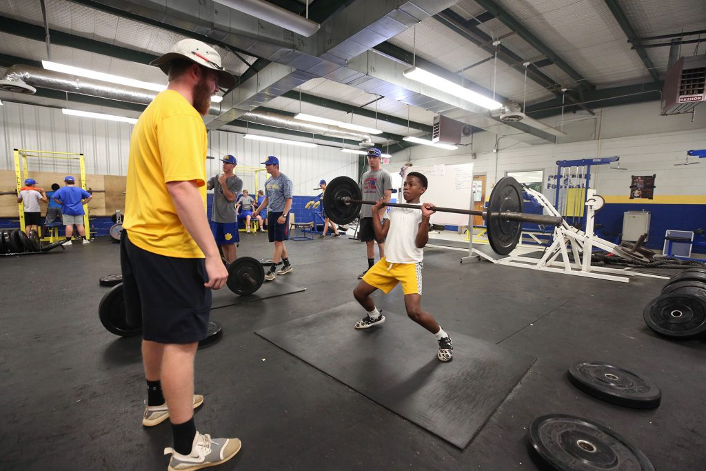 Baseball students lift in the Panther Field House.