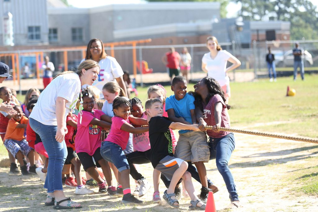 QLE students competing in field day activities.