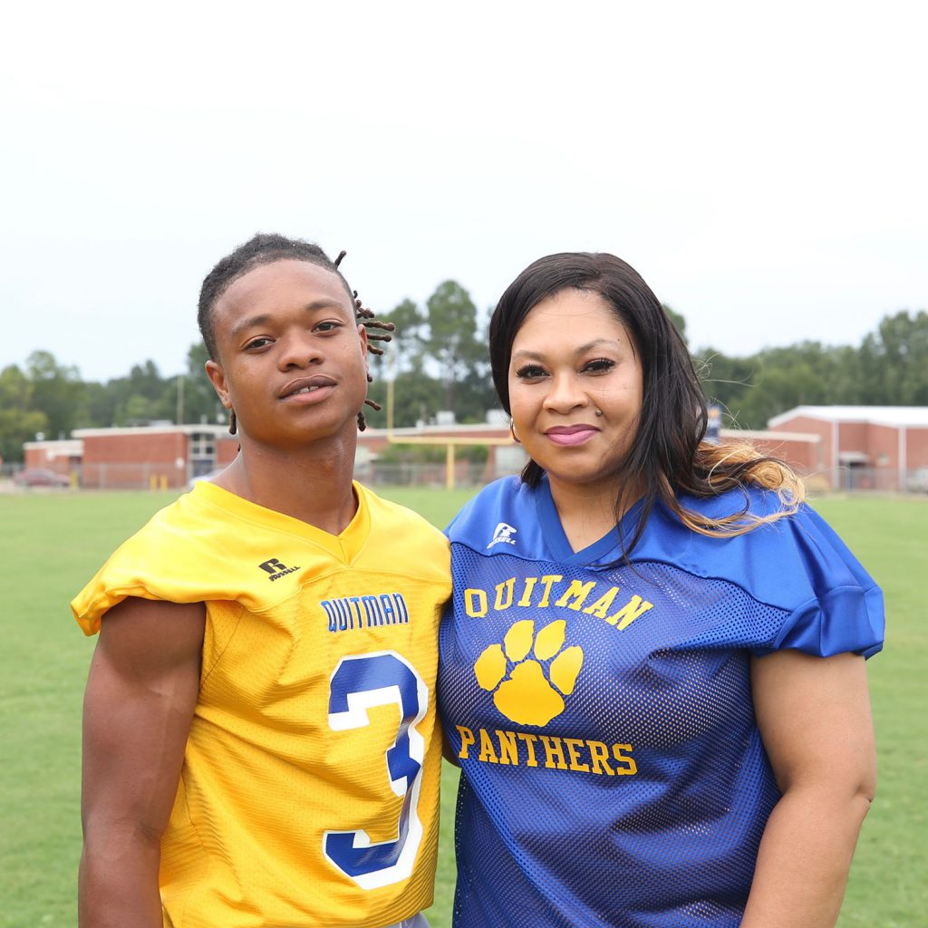 QHS Football player and his mom.