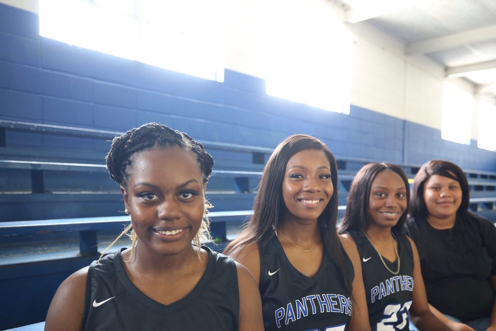 Monae posing with her fellow Lady Panther seniors.