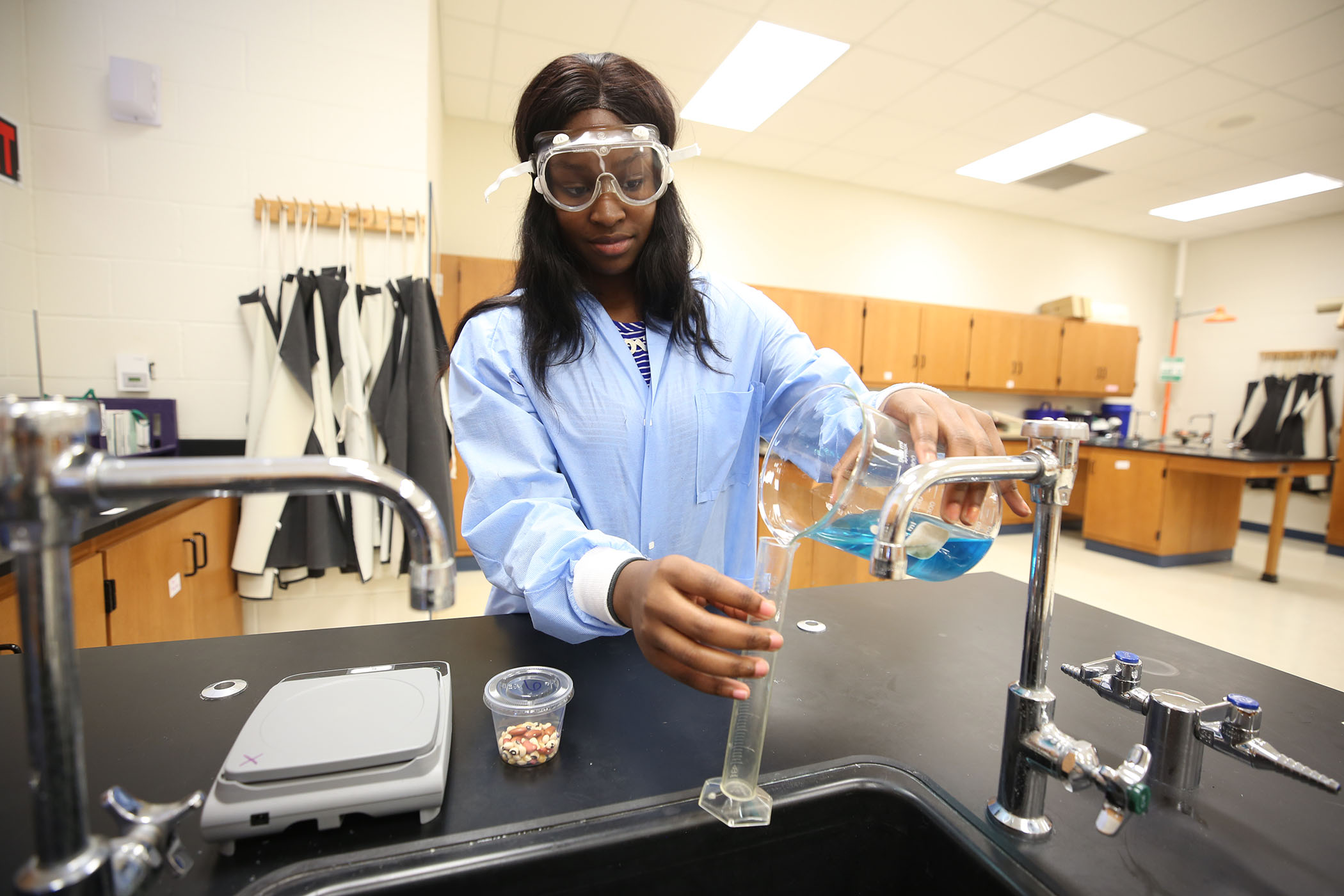AA'Cahsha poses in the chemistry lab.