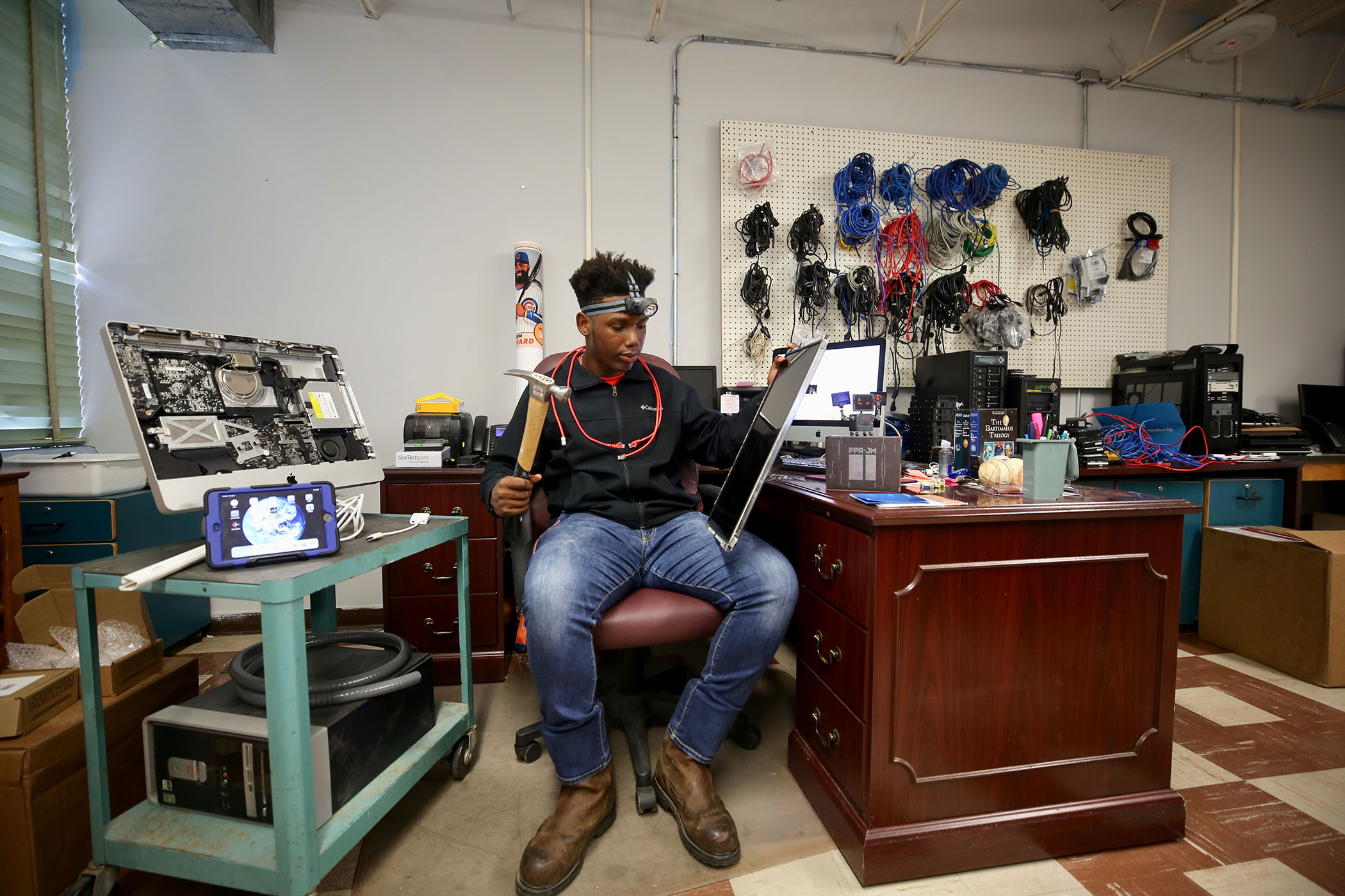 Jamal sits in the IT Department of Quitman School District.