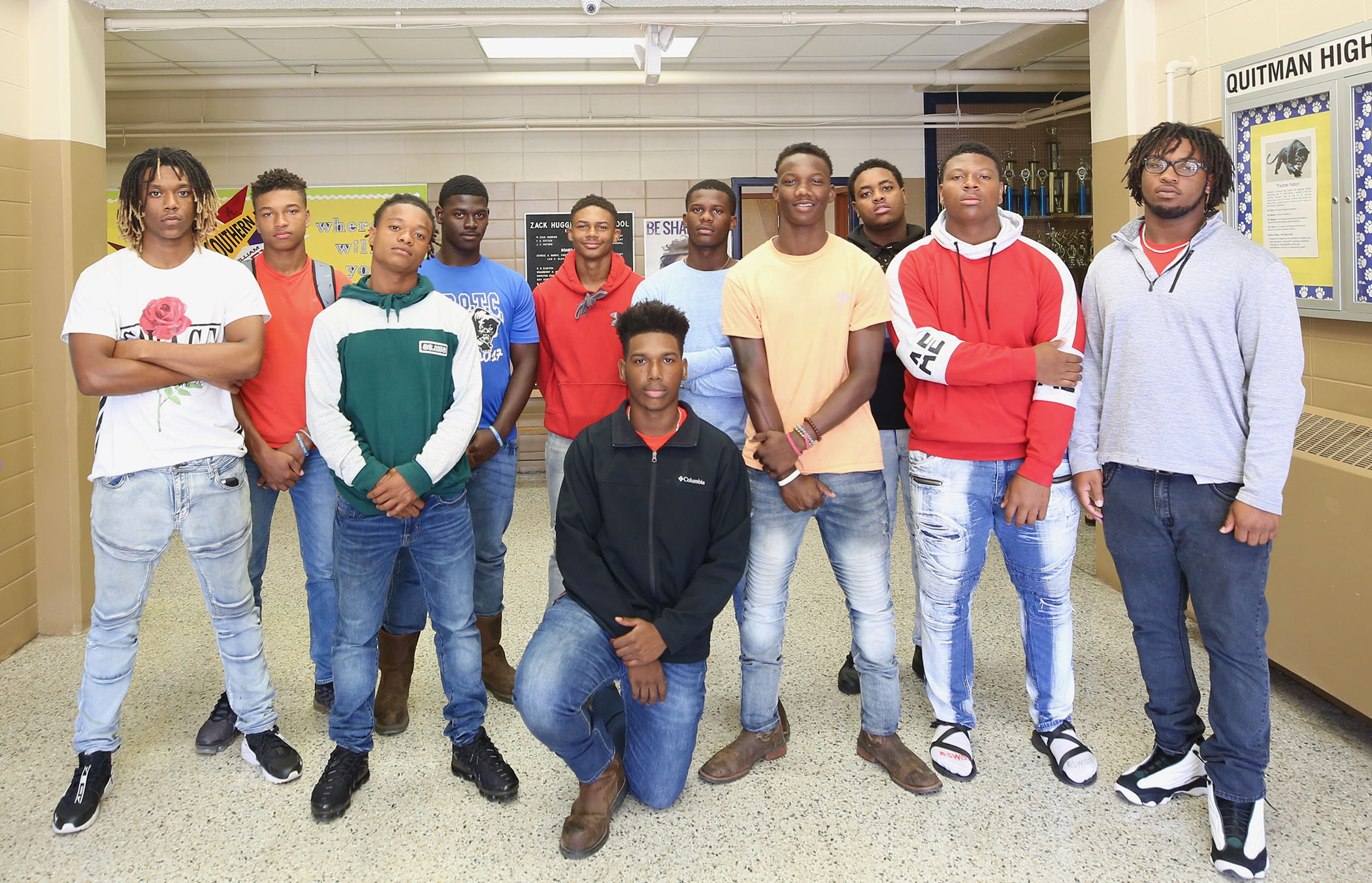 Jamal poses with his 11 brothers.